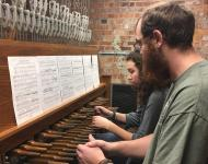 Two students playing the carillon